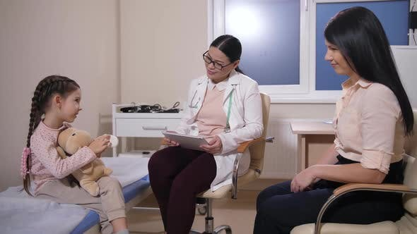 Thumbnail for Pediatrician Talking To Sick Girl in Hospital Ward