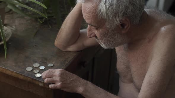 Thumbnail for Old Man Counting Coins on a Table