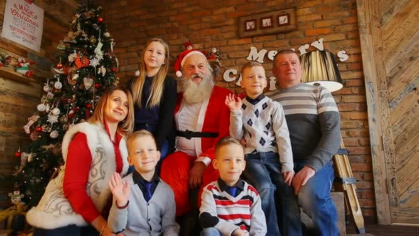 Thumbnail for Happy New York Family Photographed with Santa Claus