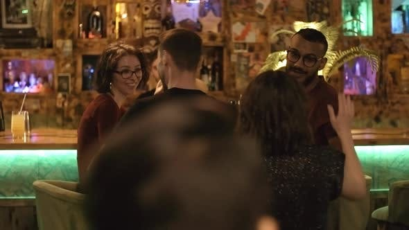 Cover Image for Friends Join Couple at Bar Counter