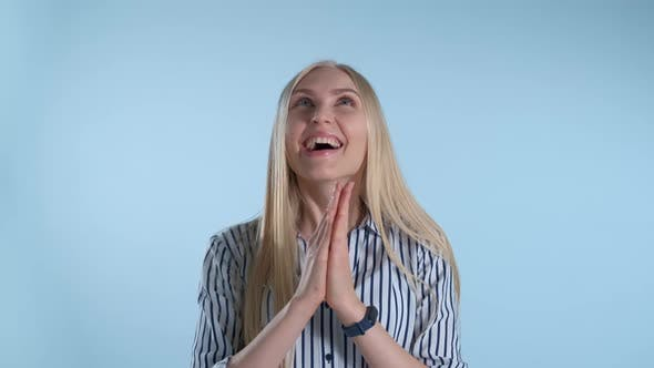 Woman Clapping Her Hands, Waiting for Something Interesting