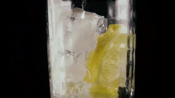Thumbnail for Pour Soda Into a Glass on a Black Background.