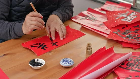 Thumbnail for Man write chinese calligraphy for lunar new year
