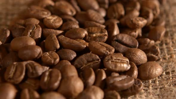 Thumbnail for Handful of Coffee Beans on Burlap Sacking, Background, Close Up, Rotation