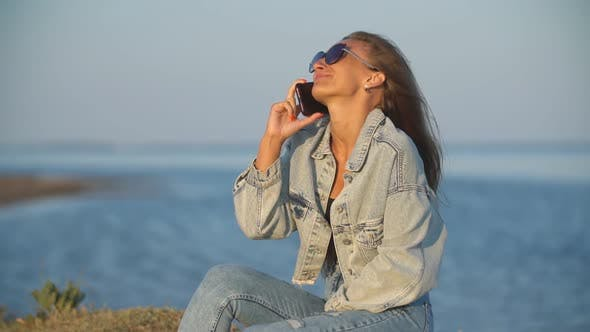 Thumbnail for Girl in Sunglasses Talking on the Phone