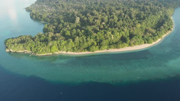 Cover Image for Flying over tropical Ai island white sand beach Banda Islands Maluku Indonesia