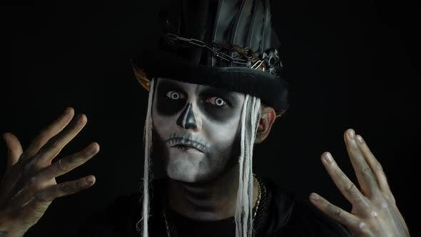 Thumbnail for Man in Skeleton Halloween Cosplay Costume. Guy in Creepy Skull Makeup Making Faces, Looks Mysterious