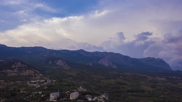 Mountains and Colorful Sky with Clouds