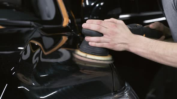 Thumbnail for Male Hands Waxing Car