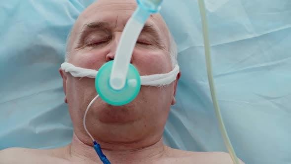 Unconscious Patient with Oxygen Mask