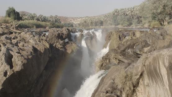 Thumbnail for Beautiful Rocky Waterfall and Rainbow