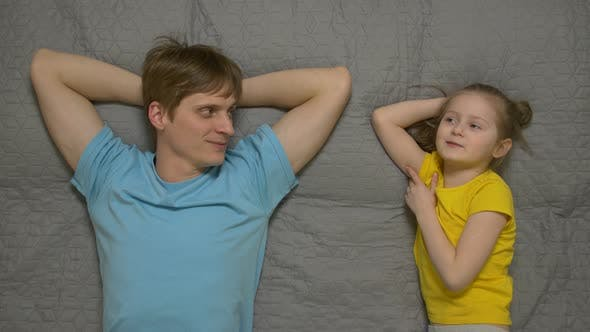 Little Girl Talks With Father