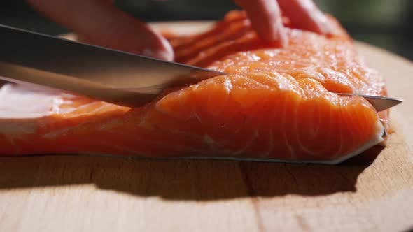 Thumbnail for Cutting Fish on Slices for Cooking Sushi in Slow Motion