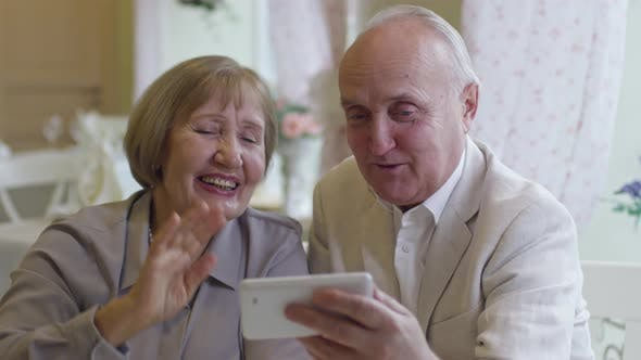 Cover Image for Senior People Having Video Call