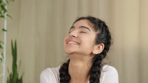Portrait of Sincere Ethnic Mixed Race Indian Hindi Teen Girl Woman Smiling Toothy Dreaming About