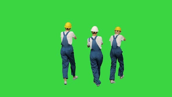 Thumbnail for Three Male Construction Workers in Hard Hats Synch Dancing with Their Backs To the Camera