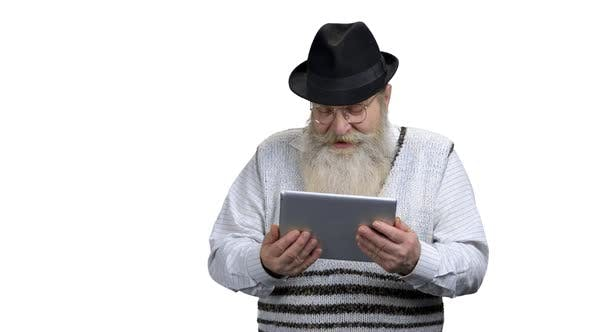 Grandfather Talking with Relatives Via Digital Tablet
