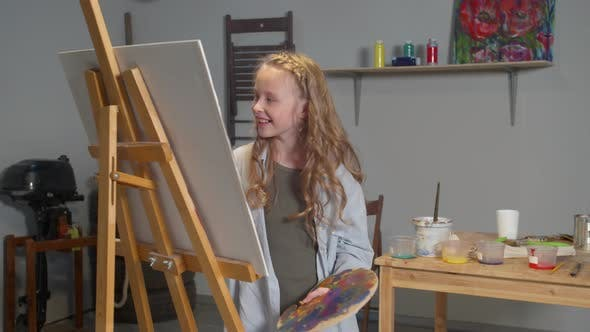 Thumbnail for Happy Girl Draws a Picture in the Studio