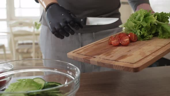 Thumbnail for Self-Sufficient Amputee with Prosthetic Forearm Making Salad