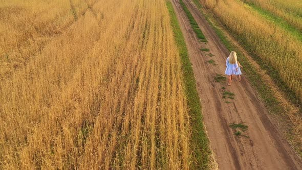 Thumbnail for Little Daughter and Mom Walk Around Field