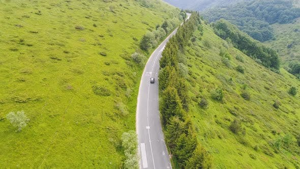 Thumbnail for Drone Chasing Car on Mountain Road