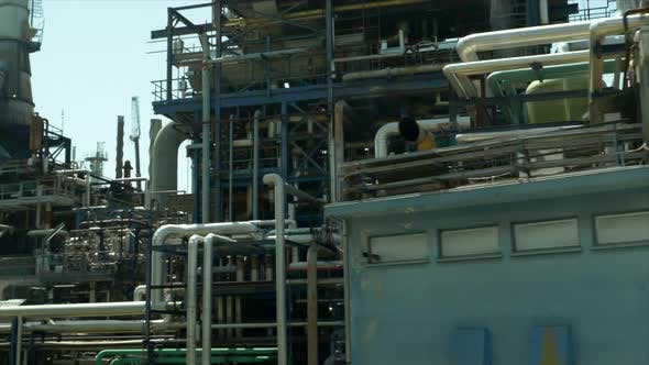 Thumbnail for Driving by an industrial oil gasoline production refinery.