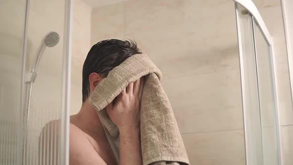 Thumbnail for Man Wiping His Face After Shower.