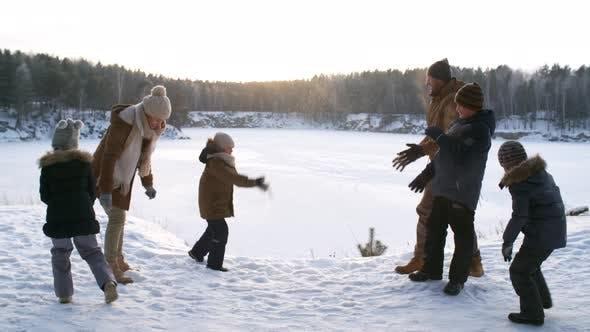 Thumbnail for Nature-Loving Family Having Snowball Fight