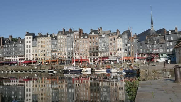 HONFLEUR, FRANCE - SEPTEMBER 2016 Beautiful port in northern Normandy by the day with colorful facad