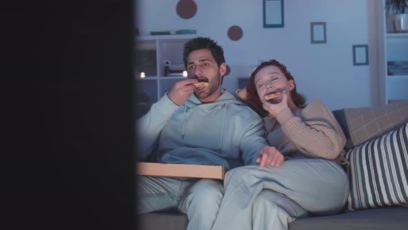 Thumbnail for Couple Enjoying Pizza at Night