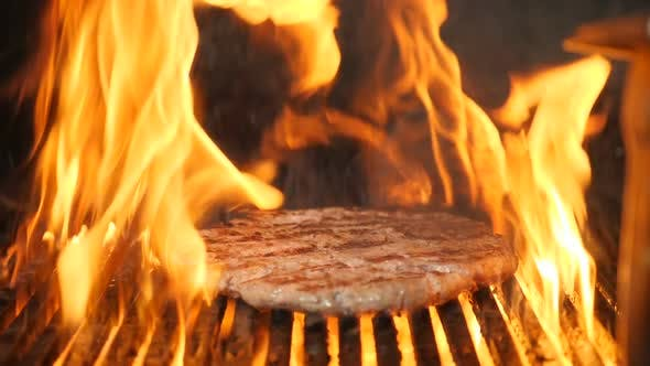 Thumbnail for Cooking Meat for Burger on Grill in Slow Motion. Flame Rising Up From Grid. Beautiful Slow Motion