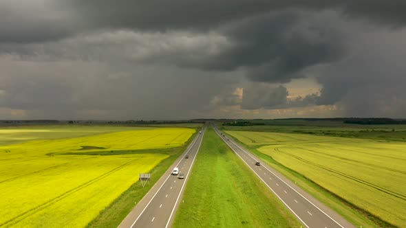 The storm clouds over the highway, view from a drone