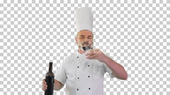 Chef tasting red wine and enjoying it, Alpha Channel