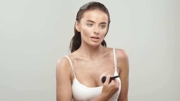 Thumbnail for Pretty Woman Doing Makeup for Her Boobs