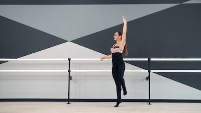 Female Dancer Training in Ballet Studio