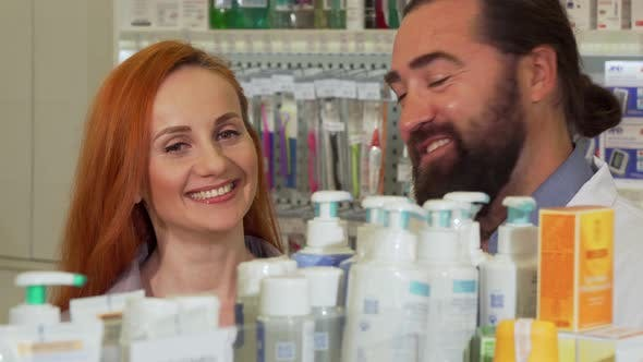 Thumbnail for Handsome Bearded Pharmacist Giving His Female Customer Requested Product