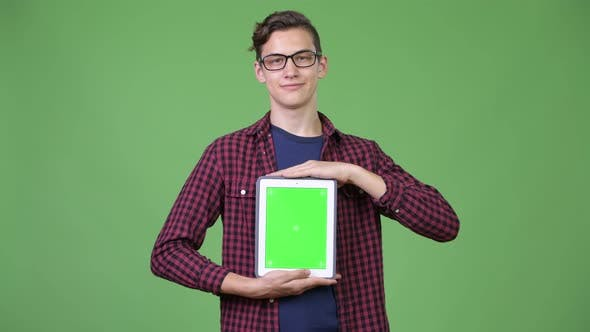 Thumbnail for Young Handsome Teenage Nerd Boy Showing Digital Tablet