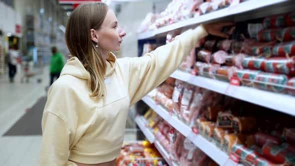 Thumbnail for Footage Woman Buys Sausage in Supermarket