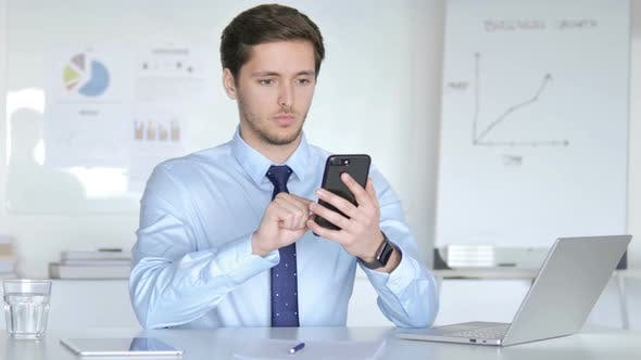 Thumbnail for Young Businessman Using Smartphone, Typing Message