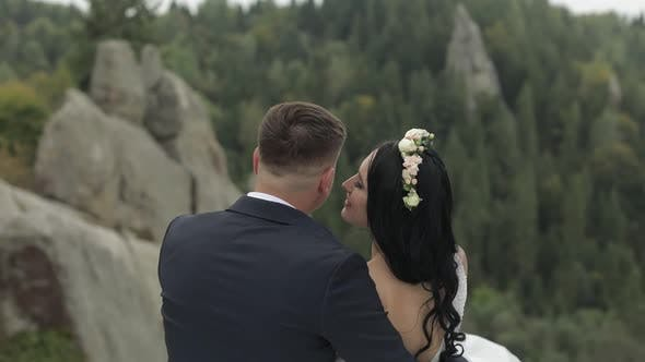 Thumbnail for Groom with Bride Sitting on the Mountain Hills. Wedding Couple in Love