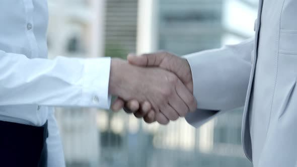 Thumbnail for Closeup Shot of People Shaking Hands