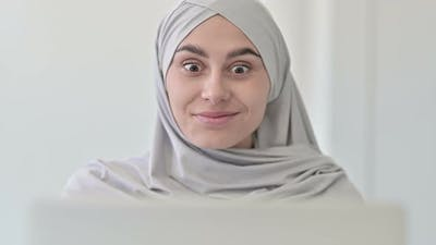 Arab Woman with Laptop Celebrating Success