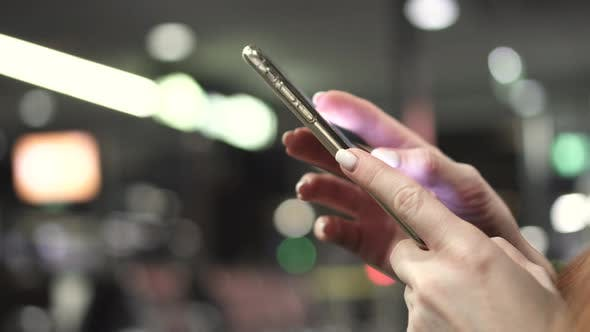 Thumbnail for Woman Uses Smartphone in Airport Terminal, Close-up of Hands