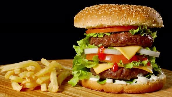 Thumbnail for Craft Beef Burger and French Fries on Wooden Table Isolated on Black Background