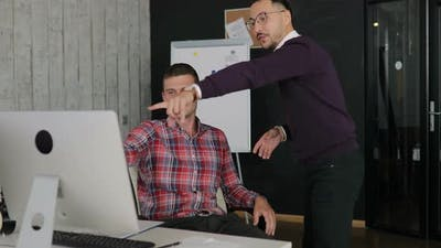 Man Emotionally Discuss What is Happening on the Monitor
