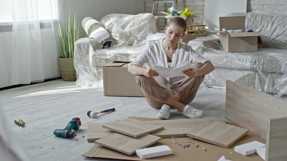 Thumbnail for Confused Woman Assembling Furniture