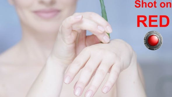 Woman Putting A Drop Of Aloe Vera On Her Palm And Moisturizing Skin A Concept Of Healthy Cosmetics