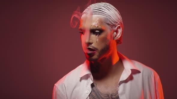 Man with Make-Up Blowing Smoke Rings