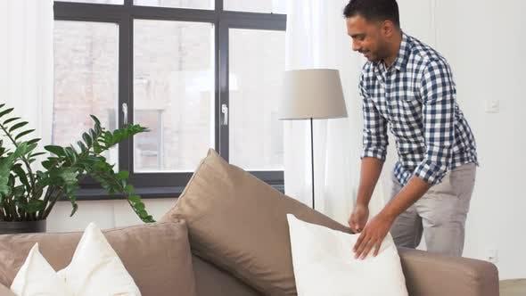 Thumbnail for Indian Man Arranging Sofa Cushions at Home 45