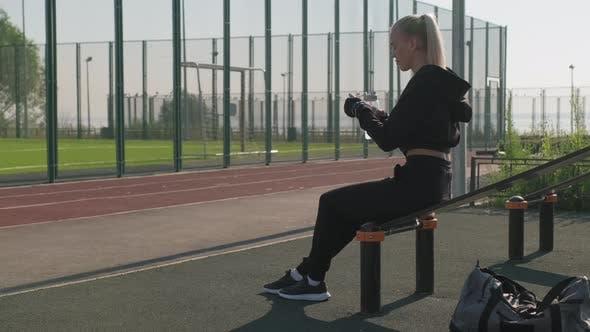 Sportswoman Drinking Water During Workout